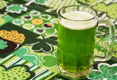 Beer on at Irish Tablecloth. Beer on an Irish tablecloth with nobody Royalty Free Stock Photo