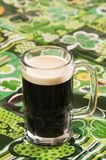 Beer on at Irish Tablecloth. Beer on an Irish tablecloth with nobody Stock Photos