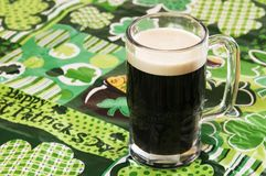 Beer on at Irish Tablecloth. Beer on an Irish tablecloth with nobody Royalty Free Stock Photography