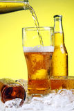 Beer Is Pouring Into Glass Stock Photo