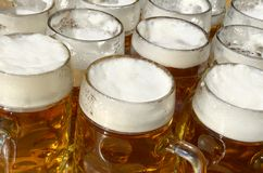 Beer jugs in sommer beer garden Stock Photo