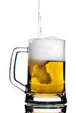 Beer keg. Contrast keg filled with light beer  on white Royalty Free Stock Image
