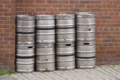 Beer kegs. A row of beer kegs outside a pub Stock Photos