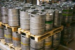Beer kegs. many metal beer keg stand in rows in a warehouse