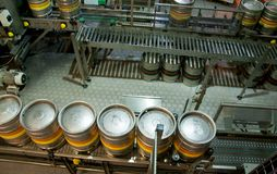Beer kegs on the production line in the factory Stock Photo