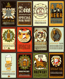 Beer labels design for winter holideys. Beer labels set design contains images of beer mug,beer glass, brewery,ribbon,helmet with beer mug,beer bottles, griffin stock illustration