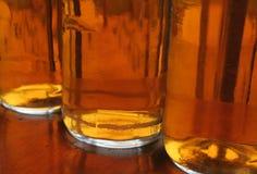Beer Line. Three bottles of beer, backlit Royalty Free Stock Photos