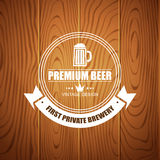 Beer logotype for beer house, brewing company, restaurant, pub, bar on wood background Royalty Free Stock Images