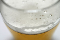 Beer - macro. Macro, shallow DOF with focus on the foreground royalty free stock photos