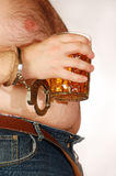 Beer on male belly Royalty Free Stock Photos