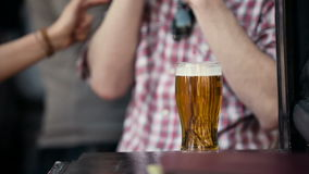 Beer. Man in a bar with a beer stock footage