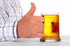 Beer in man hand stock image