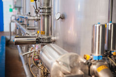 Beer manufacture line. Equipment for staged production bottling of Finished food products. Metal structures, pipes and tanks at en. Terprise factory. Special Stock Photo