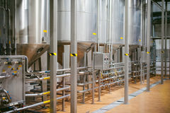 Beer manufacture line. Equipment for staged production bottling of Finished food products. Metal structures, pipes and tanks at en Royalty Free Stock Images
