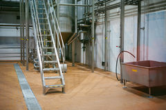 Beer manufacture line. Equipment for staged production bottling of Finished food products. Metal structures, pipes and tanks at en. Terprise factory. Special Royalty Free Stock Photos