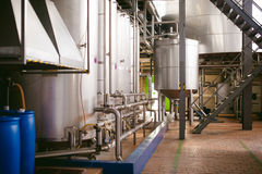 Beer manufacture line. Equipment for staged production bottling of Finished food products. Metal structures, pipes and tanks at en. Terprise factory. Special Royalty Free Stock Photo