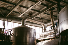 Beer manufacture line. Equipment for staged production bottling of Finished food products. Metal structures, pipes and tanks at en Royalty Free Stock Photos