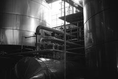 Beer manufacture line. Equipment for staged production bottling of Finished food products. Metal structures, pipes and tanks at en. Terprise factory. Special Stock Images