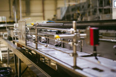 Beer manufacture line. Equipment for staged production bottling of Finished food products. Metal structures, pipes and tanks at en. Beer production line Royalty Free Stock Image