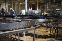Beer manufacture line. Equipment for staged production bottling of Finished food products. Metal structures, pipes and tanks at en. Beer production line Stock Image