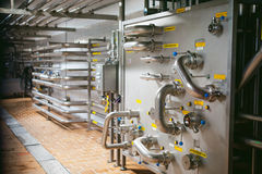 Beer manufacture line. Equipment for staged production bottling of Finished food products. Metal structures, pipes and tanks at en. Corridor in a production Royalty Free Stock Photo