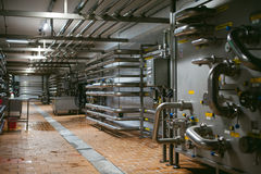 Beer manufacture line. Equipment for staged production bottling of Finished food products. Metal structures, pipes and tanks at en. Corridor in a production Royalty Free Stock Images