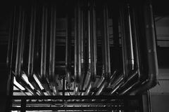 Beer manufacture line. Equipment for staged production bottling of Finished food products. Metal structures, pipes and tanks at en. Production building with Royalty Free Stock Images