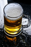 Beer on mirrow table Royalty Free Stock Photography
