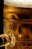 Beer mug. Full beer mug with foam on the dark background Royalty Free Stock Photos