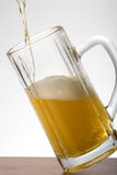 Beer mug. Filling glass of cold beer Royalty Free Stock Image