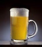 Beer mug. On bar with water drops on glass Stock Image