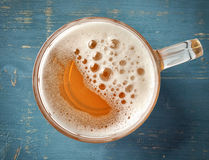 Beer mug on blue wooden table Royalty Free Stock Image