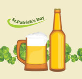 Beer mug and bottle on the seamless background with clover leaves Royalty Free Stock Photo