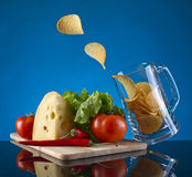 Beer mug and chips Royalty Free Stock Photography