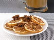 Beer mug with cinnamon and lemon on white plate Stock Images