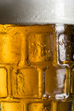 Beer mug. Close up of a cold light beer in a mug Stock Image