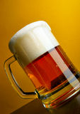 Beer mug close-up with froth stock photography