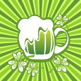 Beer mug and clover Stock Photography