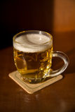 Beer mug on a coaster Stock Images