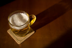 Beer mug on a coaster Stock Photo