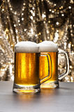 Beer mug in front of a glittering background Stock Images