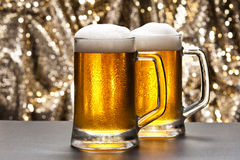 Beer mug in front of a glittering background Royalty Free Stock Image