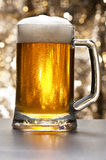 Beer mug in front of a glittering background Stock Photo