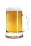 Beer mug with froth. Isolated over a white background royalty free stock photo