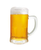 Beer mug. A mug of beer with froth and slight spill stock image