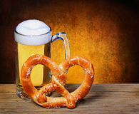 Beer Mug with German Pretzel on wooden table. isolated Royalty Free Stock Photo