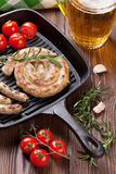 Beer mug and grilled sausages Stock Photos