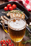 Beer mug and grilled sausages Royalty Free Stock Photography