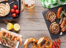 Beer mug, grilled shrimps, sausages and pretzel Royalty Free Stock Photo
