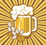 Beer mug and hops. On a striped background Stock Photo